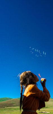 Ajdana blows soap bubbles