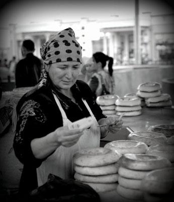 Bazaar of Tashkent, Uzbekistan -  flatbread saleswoman