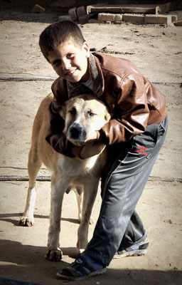Mary, Turkmenistan - boy with his dog