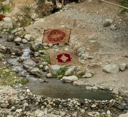 In the river washed carpets dry on the earth