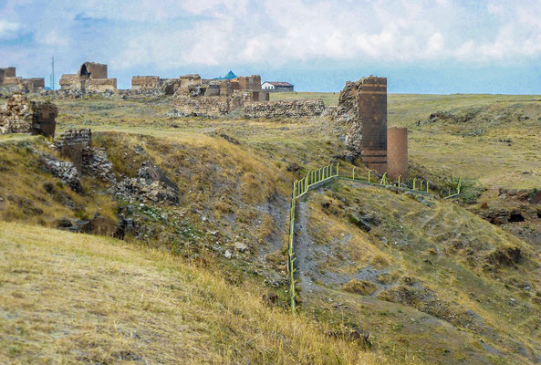 Fortifications. A modern border fence can be seen at center, Armenia is on the right, Turkey, on the left