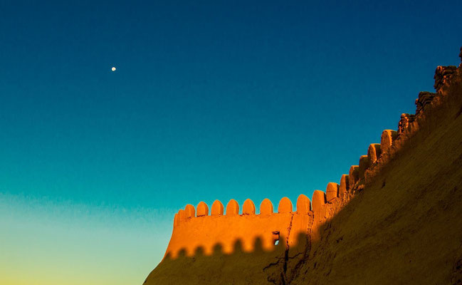 Khiva's wall at sunset. The contrast of red sunlight on the curves of the wall and the sky is what i tried to catch and had to wait a long time for this magical moment