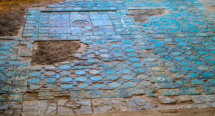 exposed and restored remains of the floor mosaic can give an impression of the former splendor of the palace