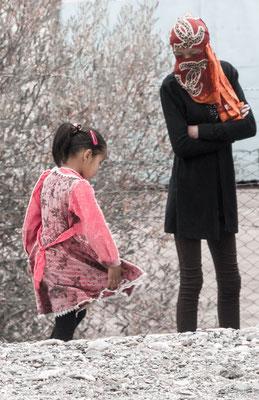 The girl shows her mother her pretty dress. Murghab, Gorno-Badakhshan Autonomus Region, Tajikistan