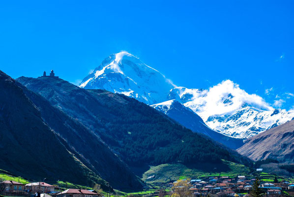 The Mt.Kazbek (5049 m), is one of the highest and most beautiful mountains of Caucasus