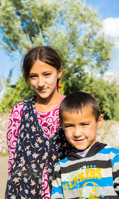 Tajikistan, village of Vrang - Muslima and her brother