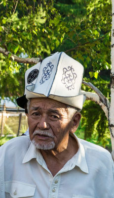 Kirgistan - man wearing an Ak-Kalpak (white cap)