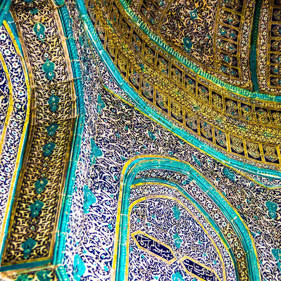 The beautiful golden and emerald green vault of the dome