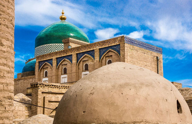 A beautiful emerald green dome topped with a gleaming gold orb marks the tomb of Pakhlavan Mahmoud - the holiest site in Khiva