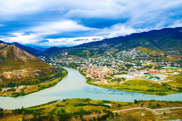 Mtskheta, at the confluence of the rivers Kura (in the middle) and Aragvi which flows from the north (right) direction Tbilisi (left) - In the center of the picture the Svetitskhoveli Cathedral