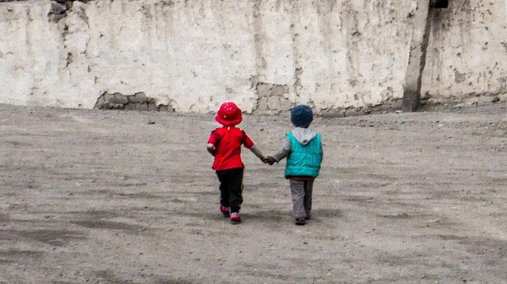 Frends on a street in Murghab, Gorno-Badakhshan Autonomus Region, Tajikistan