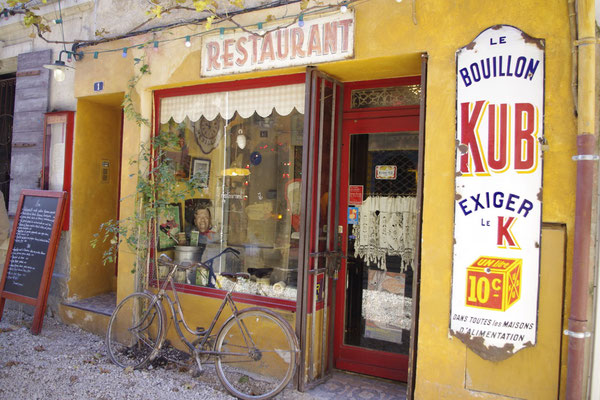 a picturesque coffee shop in a Provence village