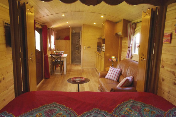 The living room and the gipsy caravan bath room