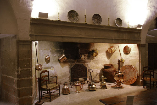 The large fireplace and the copper dishes
