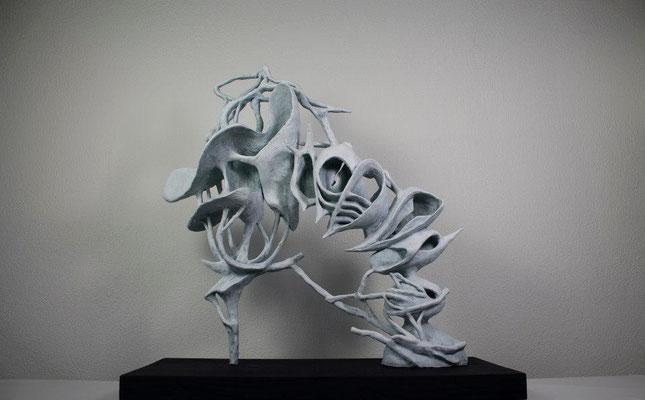 Spin  (47cm x 22cm x 50cm)  polymer clay piece on a rectangular wooden base