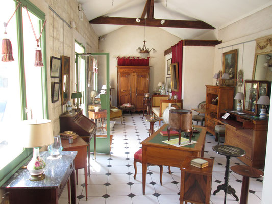 "Antiques shop ""Les Petites Ecuries"". First exhibition hall. There were three others in the courtyard."