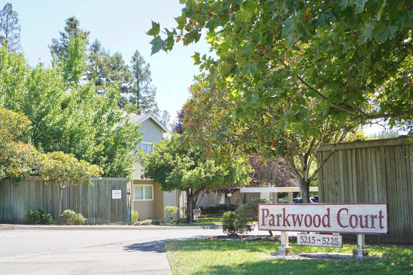 front entrance of Parkwood Court Apartments with signage