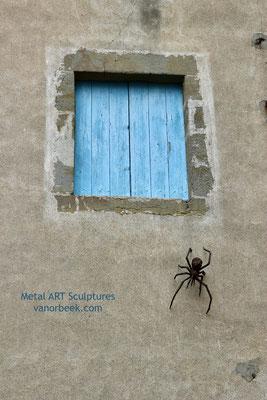 beeldhouwwerk spin
