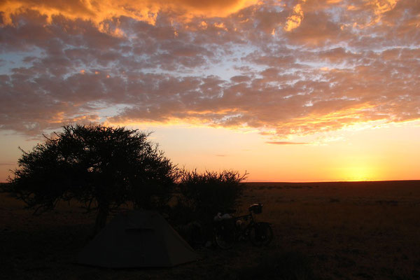 Camp and sunset at Namib Desert