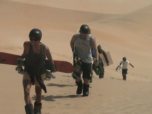 Me and a couple of guys climbing a dune - Swakopmund