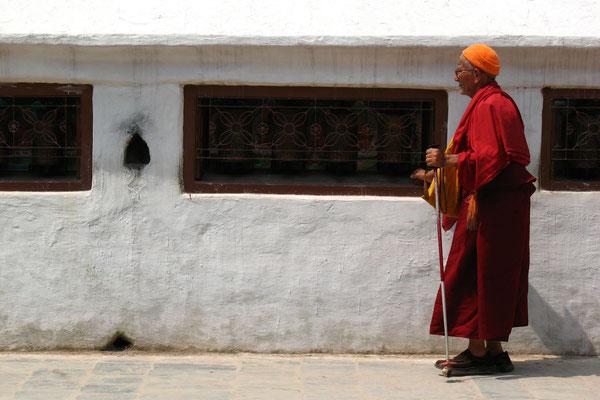 Tibetan monk circumambulating Bodnath Stupa - Kathmandu