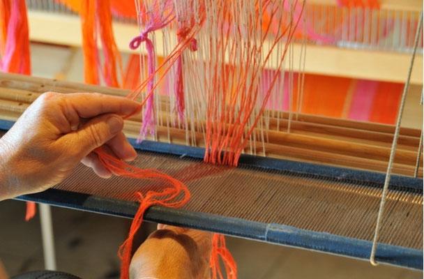 Le peigne défini la largeur du tissu