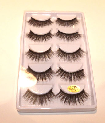 I got these eyelashes with adhesive tape from the drugstore.