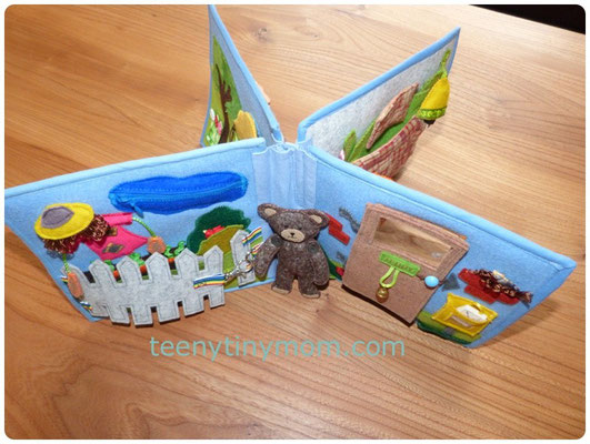 the book is able to stand upright because of the sturdy wool felt