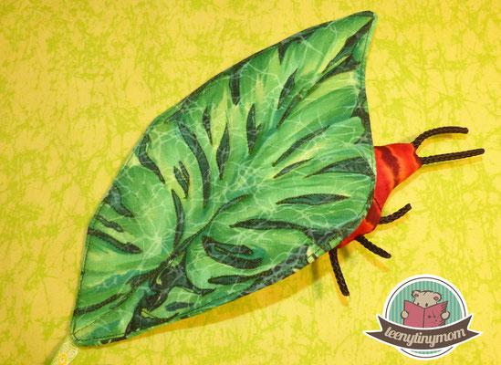 Ein stabiles Blatt entsteht, um einen Käfer zu verstecken