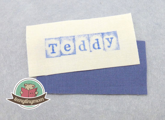 1 cm um die Schrift zuschneiden , ebenso das Gegenstück aus Stoff