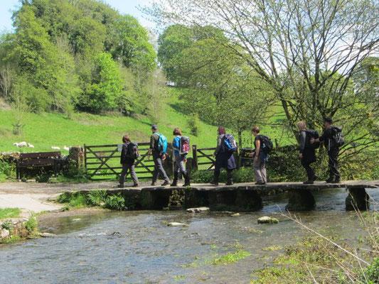 Crossing a footbridge in Bradford Dale