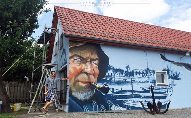 Fassadenmalerei Fischerei Geschäft mit Hilfe der Graffitikunst neu entstandenes Fassaden Konzept