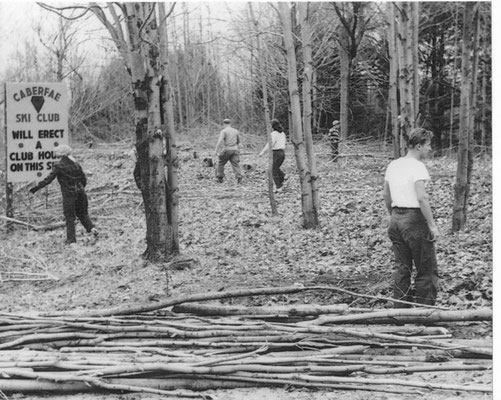 This is a photo of the first day of work at the Caberfae Ski Club. Don Thomas, pictured on the right, and other members are clearing the land for a new clubhouse. Be sure to read the sign at the upper left of the photo.