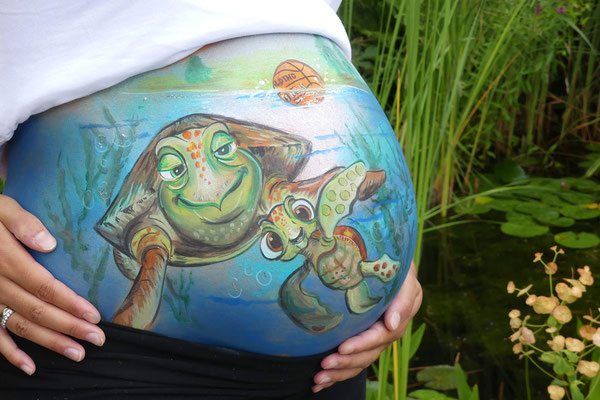 Een schildpad en papa's hobby basketbal als bellypaint
