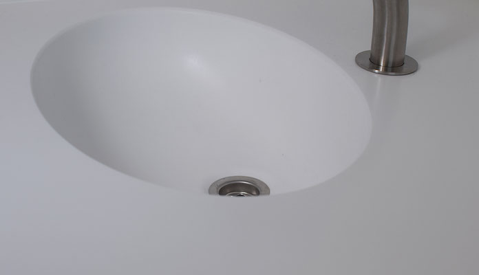 Praxismöbel Zahnarzt Speyer, Innenausbau Katz, Arbeitsplatte in Mineralwerkstoff aus einem Guß mit Waschbecken