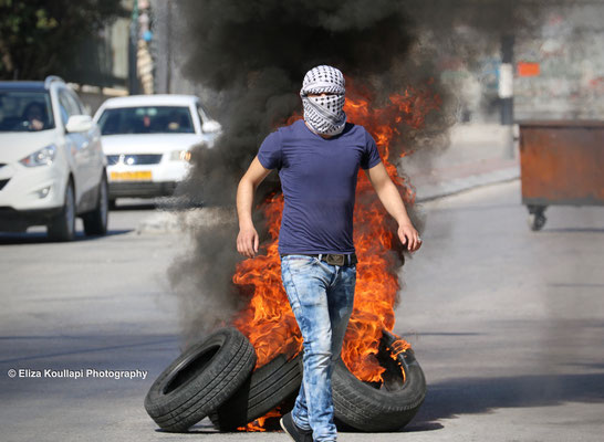 Palestinian youth during clashes in the city of Bethlehem, West Bank.