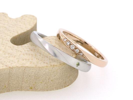 女性用リングはピンクゴールドにダイヤモンドを、男性用リングはプラチナにペリドットを