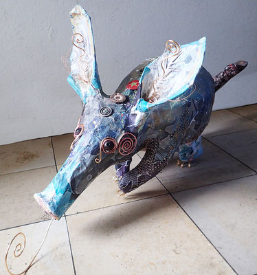 Aardvark - Paper maché, feathers, bottle caps, wire, beads