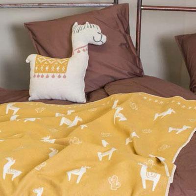 Lama-Tagesdecke und Kissen