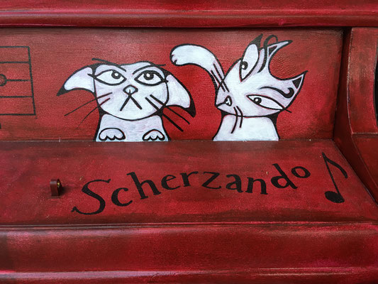 Scherzando means joking, lighthearted or playful.