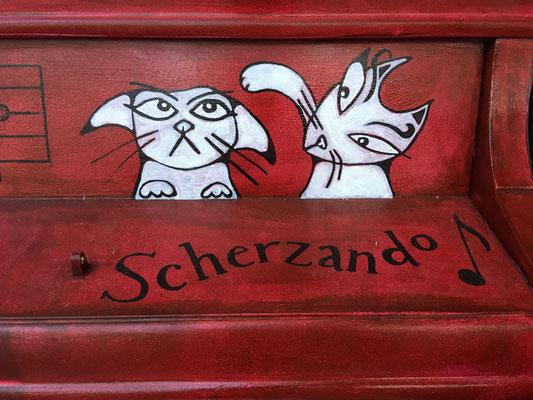 Scherzando means joking, lighthearted or playful.