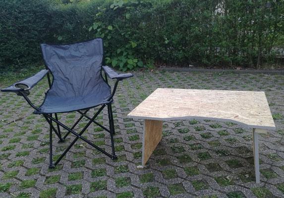 Der herausnehmbare Teil der Liegefläche fungiert hier als Tisch.