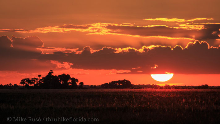 the sun sets over Kissimmee Prairie