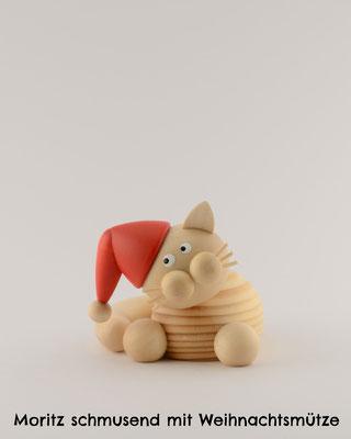 Moritz schmusend mit Weihnachtsmütze