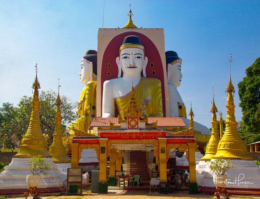 Kyaikpun-Pagode - Die Buddhas der vier Weltzeitalter Kakusandha, Konagamana, Kassapa und Gautama sitzen angelehnt an einen 30 m hohen quadratischen Pfeiler und schauen in die vier Haupthimmelsrichtungen: