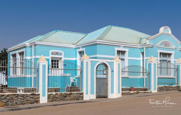 Das Haus Glück Auf - Das Haus wurde zwischen 1907 und 1908 für Karl Reinshagen errichtet. Er arbeitete als Rechtsanwalt für den Diamantenbergbau-Sektor.