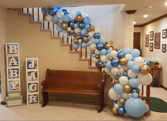 Air-filled balloon organic garland stairs rail baby blue white