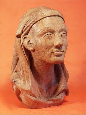Portrait einer Frau mit Kopftuch.