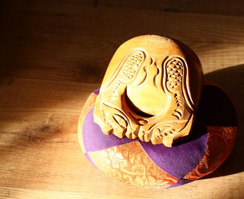 Ein Mokugyo, ein Ritualinstrument, mit dem die Rezitation vor und nach der Zen Meditation begleitet wird. Die Rezitation ist auch eine Form der Meditation