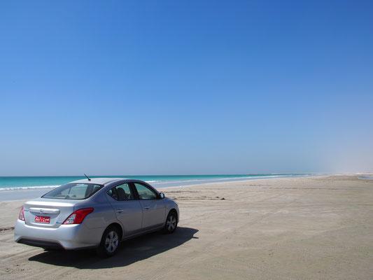 Nissan Sunny on the white sandy beach of Salalah.